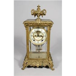 An Ansonia Gilt Brass and Glass Mantle Clock.
