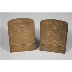 A Pair of Tiffany & Co. Bronze American Indian Pattern Bookends.