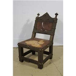 An African Carved Hardwood, Animal Hide and Brass Element Chair.