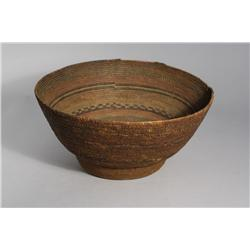 An African Coiled Grass with Colored Decoration Basket, 20th Century.