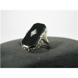 An onyx & diamond 14K white gold ring.