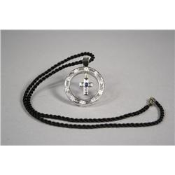 A 14kt. White Gold Sapphire and Diamond Cross Pendant with Black Woven Wool Necklace.