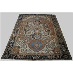 An Antique Persian Serapi Wool Rug, Late 19th Century.