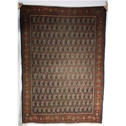 An Antique Persian Seneh Wool Rug.