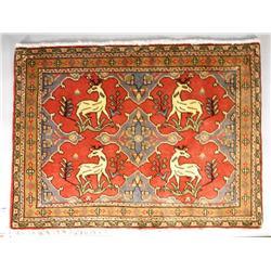 A Persian Sarouk Pictorial Wool Rug.