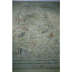 An Edward Fields Rug, with Colored Geometric Design on Ivory Field.