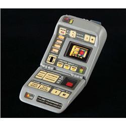 Screen-used hero illuminating Mark TR-580 Tricorder VII from Star Trek: The Next Generation