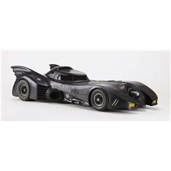 Batmobile filming miniature with cocooned maquette from Batman