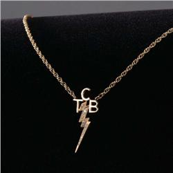 "Gold lightning bolt ""TCB"" necklace given by Elvis to his karate training partner Wayne Carman"