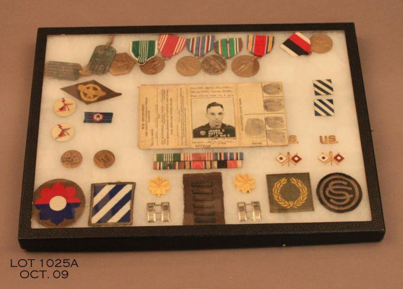 WWII US Army majors uniform grouping consisting of tunic, cap, metals,  patches and personal id tag