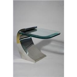A Chrome and Glass Side Table in the Style of Karl Springer.