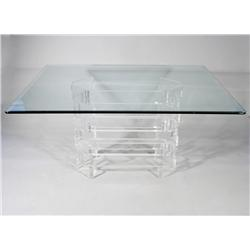A Glass and Lucite Table, in the Style of Karl Springer.