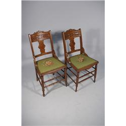 A Pair of Victorian Walnut Side Chairs with Needlepoint Seats.