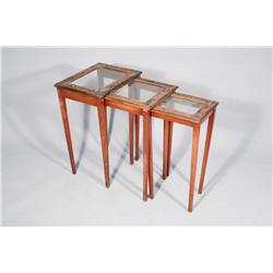 A Chinese Painted Wood and Glass Nest of Tables.