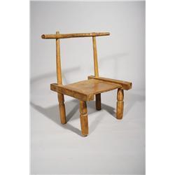 An African Carved Hardwood Benin Chair, Circa 1920.