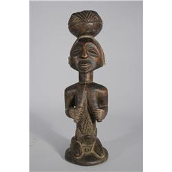 An African Carved Hardwood Tribal Figure.