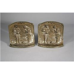A Pair of Bronze Bookends Depicting Figures Praying.