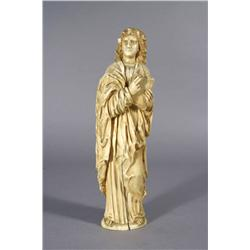 A Continental 19th Century Carved Ivory Religious Figure Holding a Bible.