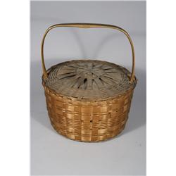 A Shaker Woven Lidded Basket with Handle.