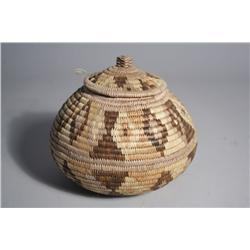 An American Indian Coiled Lidded Basket.