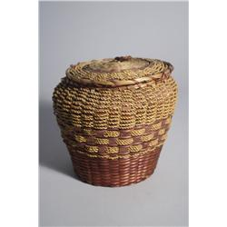 An American Indian Coiled and Woven Lidded Basket with Colored Decoration.