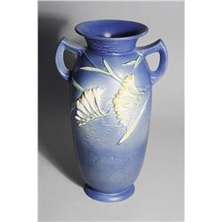 A Roseville Freesia 128-15' Pottery Vase.