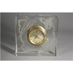 A Glass and Brass Clock.