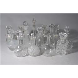 A Collection of Fourteen Glass Decanters, Including Seven Crown Staffordshire China Decanter Labels.