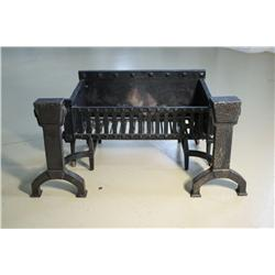A Pair of Bradley and Hubbard Cast Iron Andirons with Fire Grate.