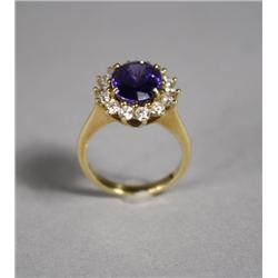 A Ladies 18 kt Yellow Gold Tanzanite and Diamond Ring.