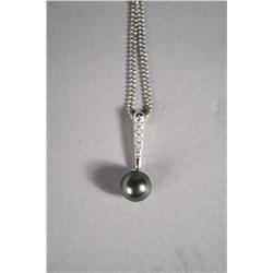 A Ladies 18 kt White Gold Tahitian Black Pearl and Diamond Pendant Necklace.