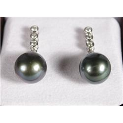 A Pair of Ladies 18 kt White Gold Black Pearl and Diamond Drop Earrings.