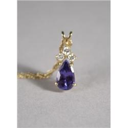 A Ladies 18 kt Yellow Gold Tanzanite and Diamond Pendant Necklace.