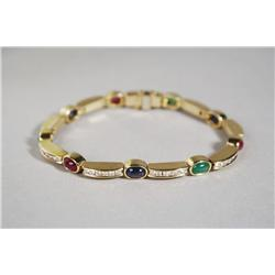 A Ladies 18 kt Yellow Gold Ruby, Sapphire and Emerald Segmented Line Bracelet.