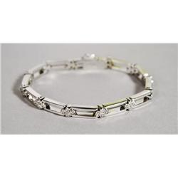 A Ladies 18 kt White Gold and Diamond Bracelet.