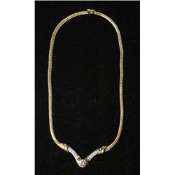 A Ladies 14 kt Yellow and White Gold and Diamond Necklace.