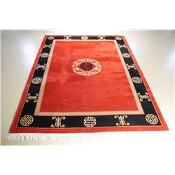 A Contemporary Red Wool Rug with Asian Motif.