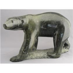 Henry Evaluardjuk Canadian, Iqaluit [1923-2007]POLAR BEAR; 1984carved serpentine9.5 x 15.5 x 8.5 in.