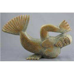 Johnny Lee Pudlat Canadian, Cape Dorset [b. 1971]SEDNA; 1996carved serpentine8.75 x 12.25 x 2.5 in.
