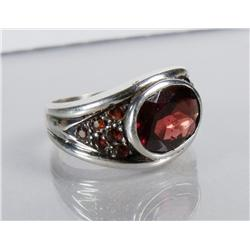 A Ladies Sterling Silver and Garnet Ring.