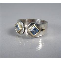 A Ladies Sterling Silver and Gold Vermeil, Blue Topaz Ring.