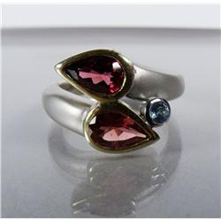 A Ladies Sterling Silver and Gold Vermeil, Garnet and Blue Topaz Ring.