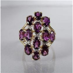 A Ladies 14 kt Yellow and White Gold, Amethyst and Diamond Ring.