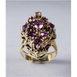 A Ladies 14 kt Yellow Gold and Amethyst Ring.