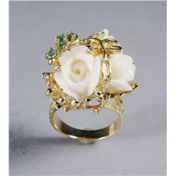 A Ladies 14 kt Yellow Gold, Carved Coral and Emerald Ring.
