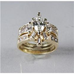A Ladies 14 kt Yellow Gold, Diamond Engagement Ring, Together with a Pair of Flanking 14 kt Yellow G