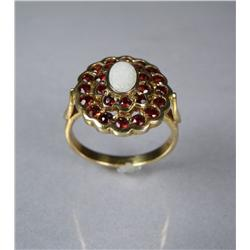 A Ladies Gold Vermeil, Garnet and Opal Ring.
