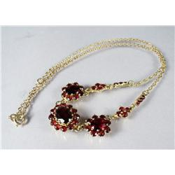 A Ladies Gold Vermeil and Garnet Necklace.