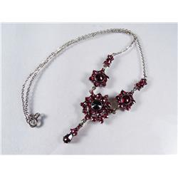 A Silver and Garnet Necklace.