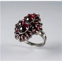 A Ladies Silver and Garnet Ring.